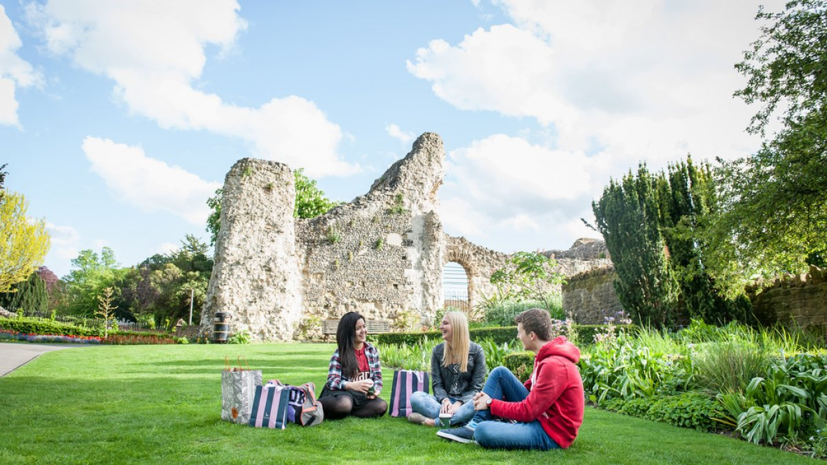 Students sitting outside near Guildford Castle