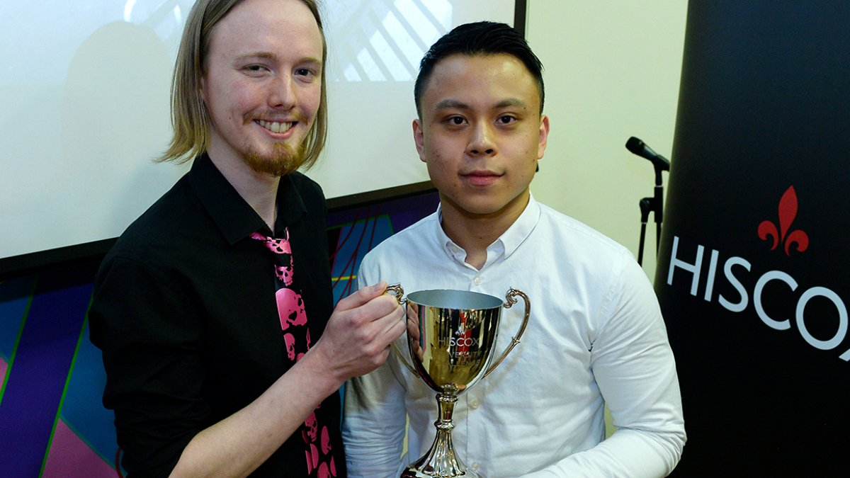 (L-r) Stewart Hutchins and Kevin Li with their trophy.