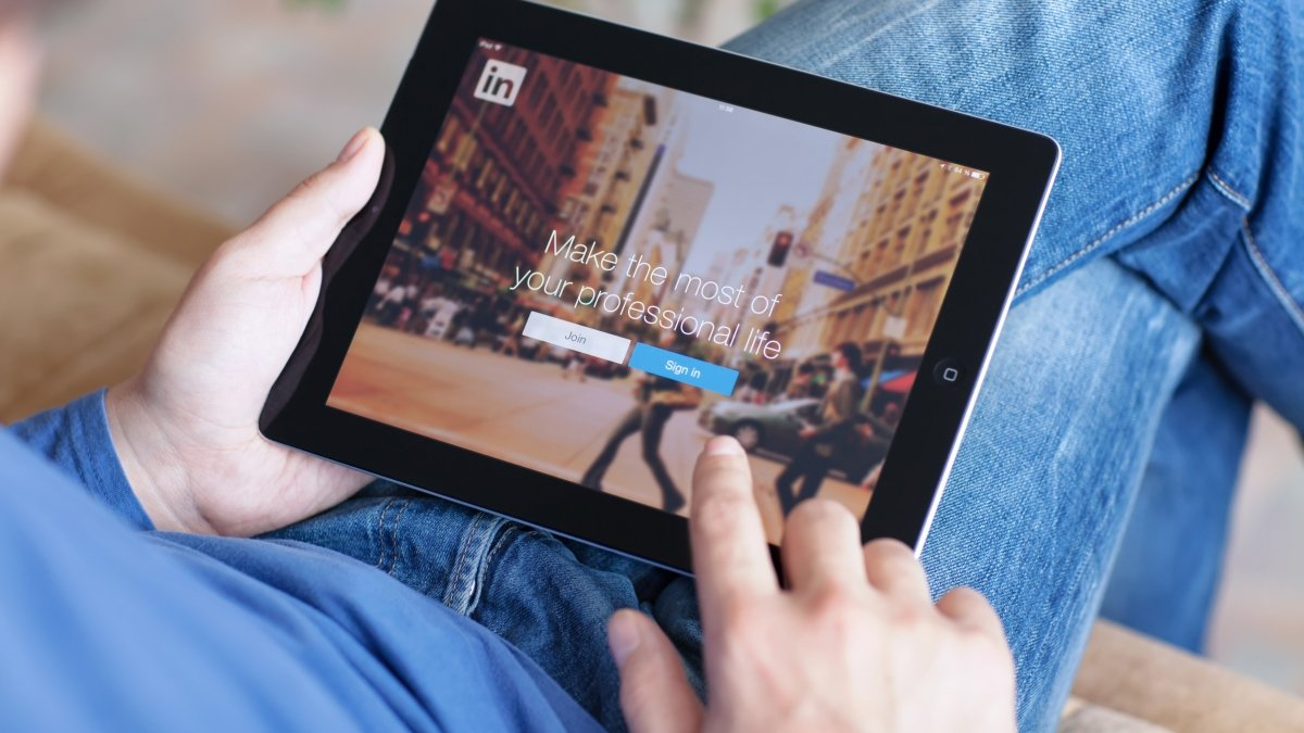 Person using LinkedIn on a tablet
