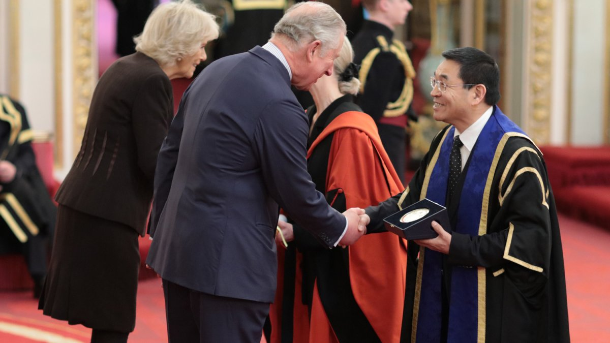 Max Lu and Sue Lanham-New being award the Queens Anniversary award at Buckingham Palace