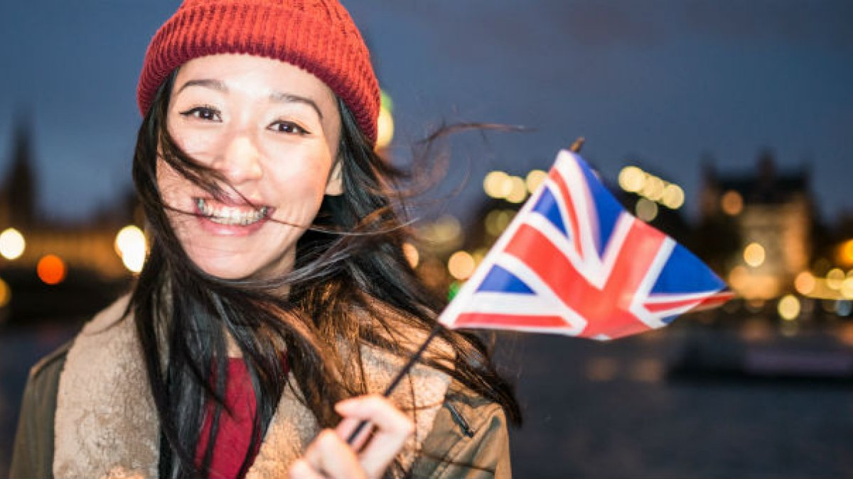 Asian woman holding union flag