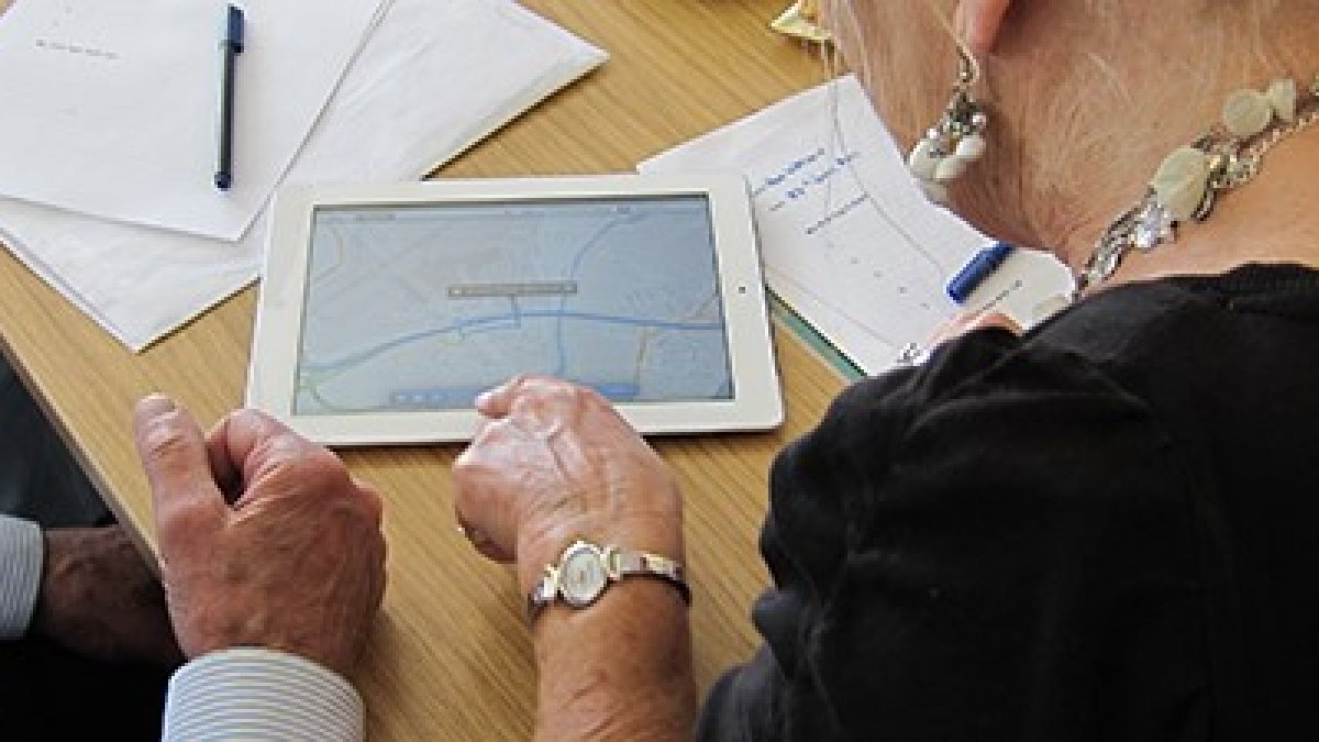 Two elderly people using a tablet