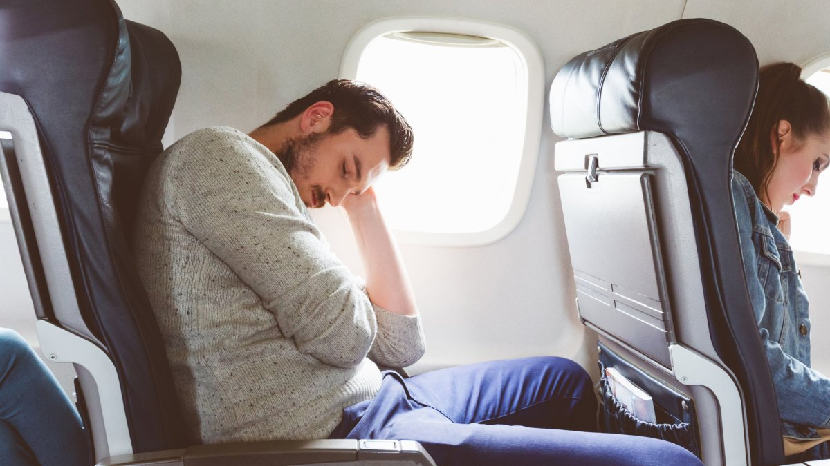 Person on plane sleeping