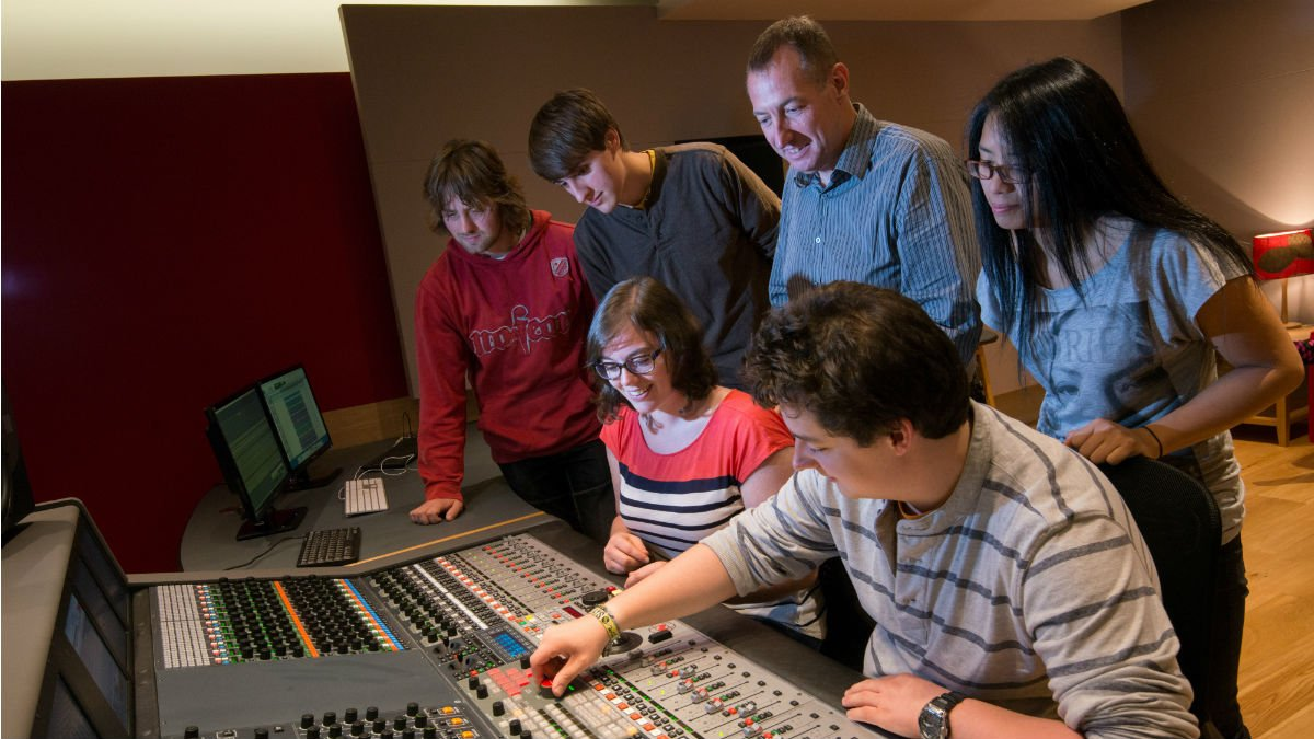 Professor Tony Myatt shows a group of Tonmeister students the mixing desk