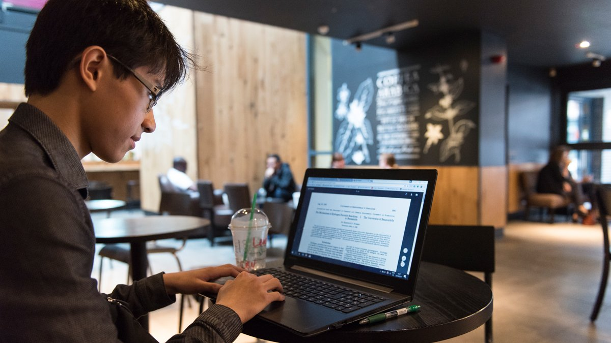 A man in Starbucks on his laptop