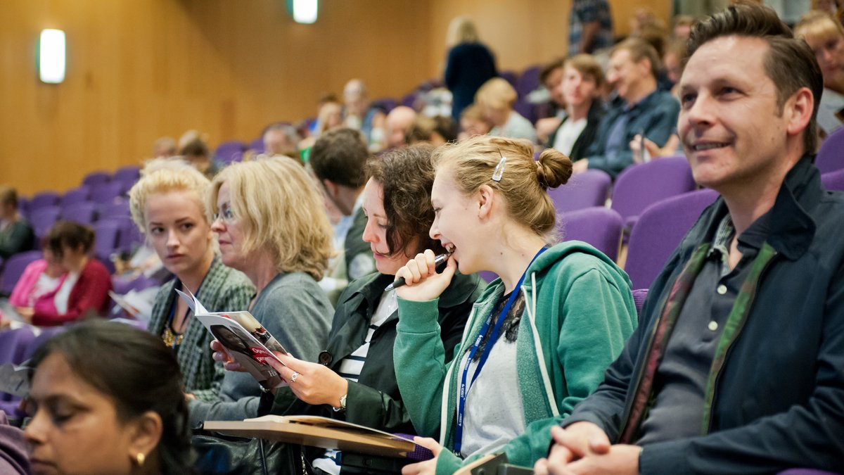 People sat in lecture theatre listening to open days talk
