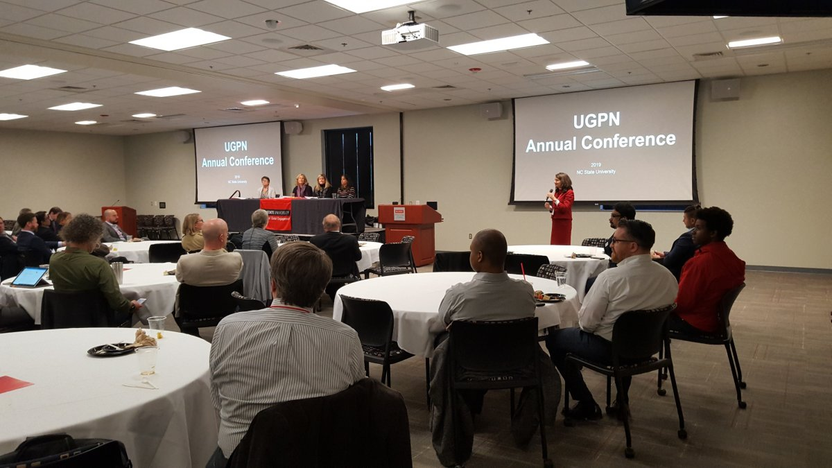 A room full of people during a talk at the April 2019 UGPN conference