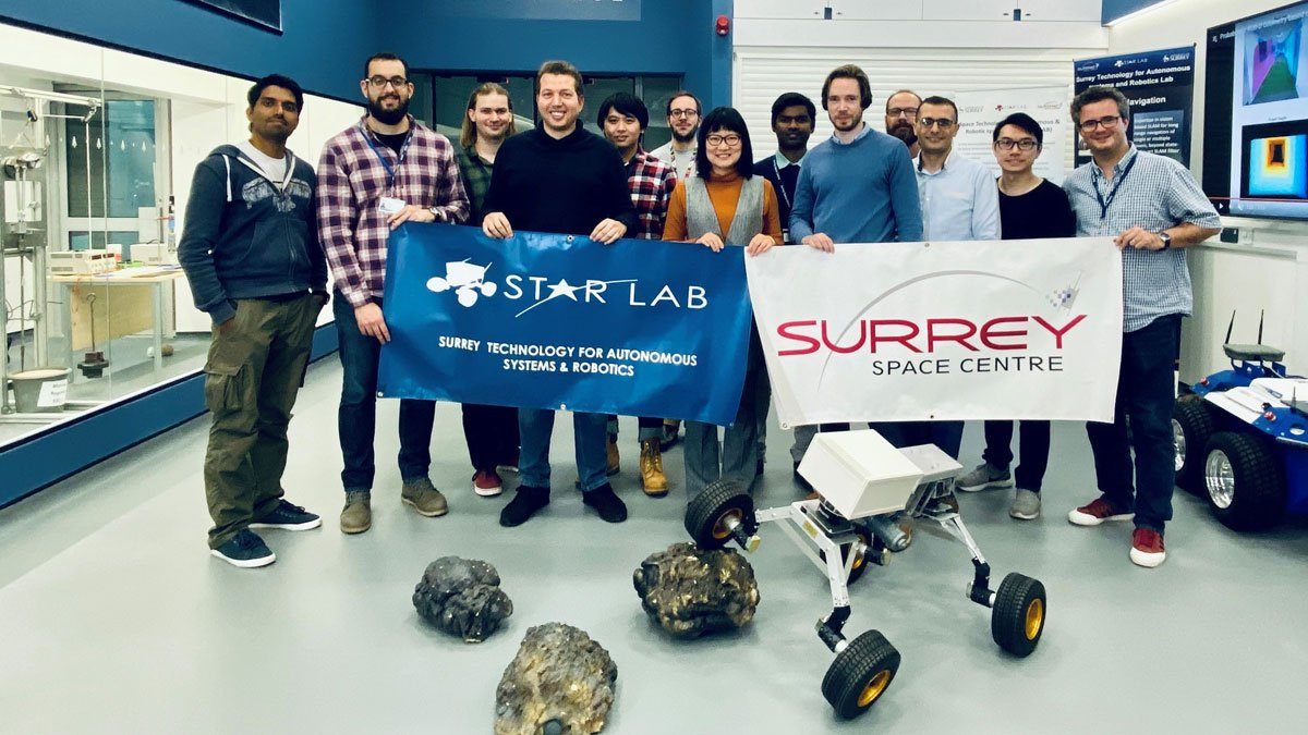 The Star Lab team holding up STAR Lab and Surrey Space Centre posters