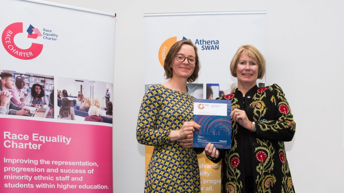 Dr. Bella Honess Roe collects Athena Swan Award