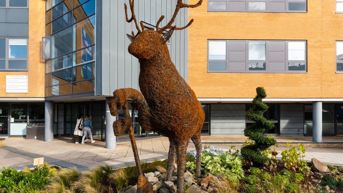Stag sculpture outside building