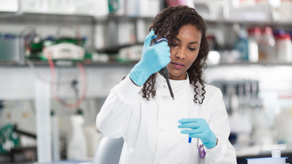 Female student holding pipette
