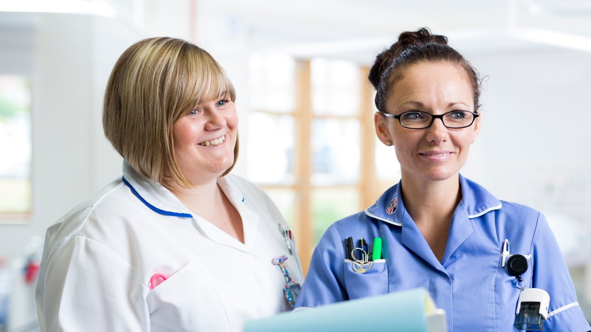 Student nurse with healthcare professional