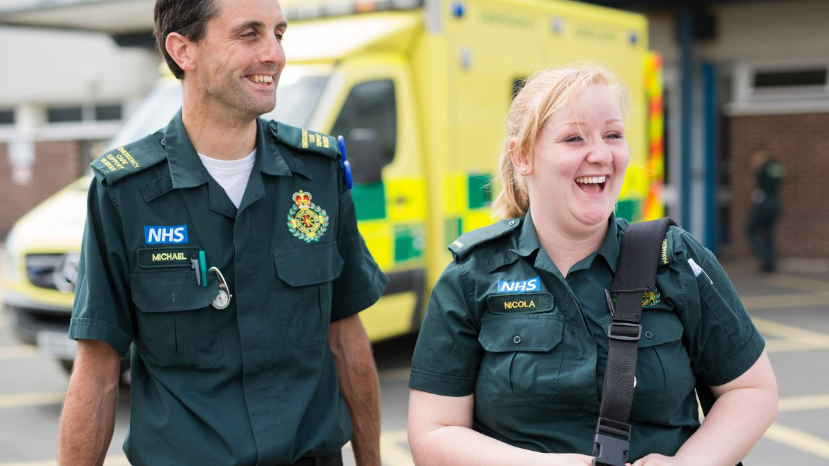 Paramedic student walking next to qualified paramedic