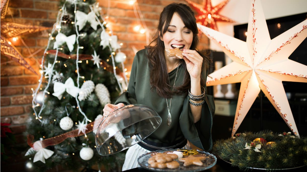Woman eating a Christmas cookie