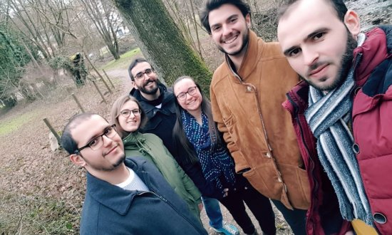Joy with colleagues in woods