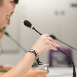 Female student using microphone